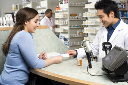 Customer at counter with pharmacist
