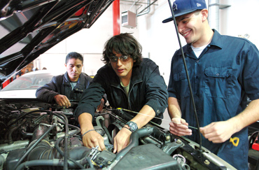 Auto repair student working on an engine